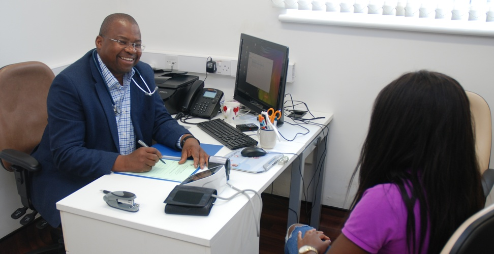 Doctor Babalola with a Patient at Rose Valley Medical Centre in London